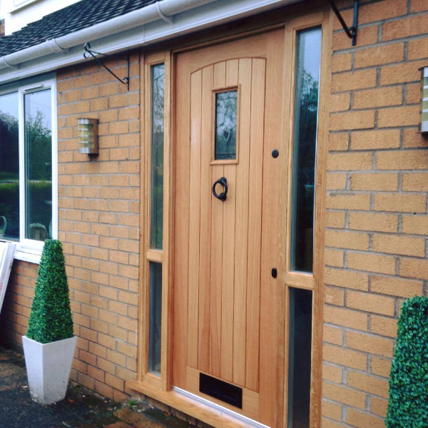 A stylish modern front door in a light wood, made and fitted by PS Joinery and Building