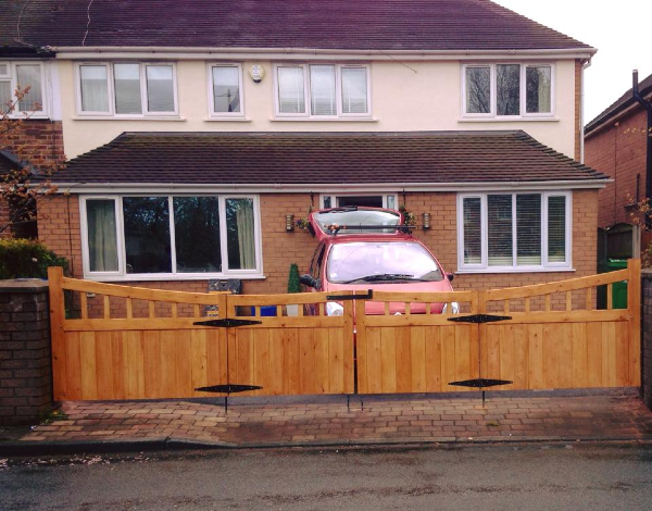 House with modern wooden gate on the driveway, built and installed by PS Joinery and Building