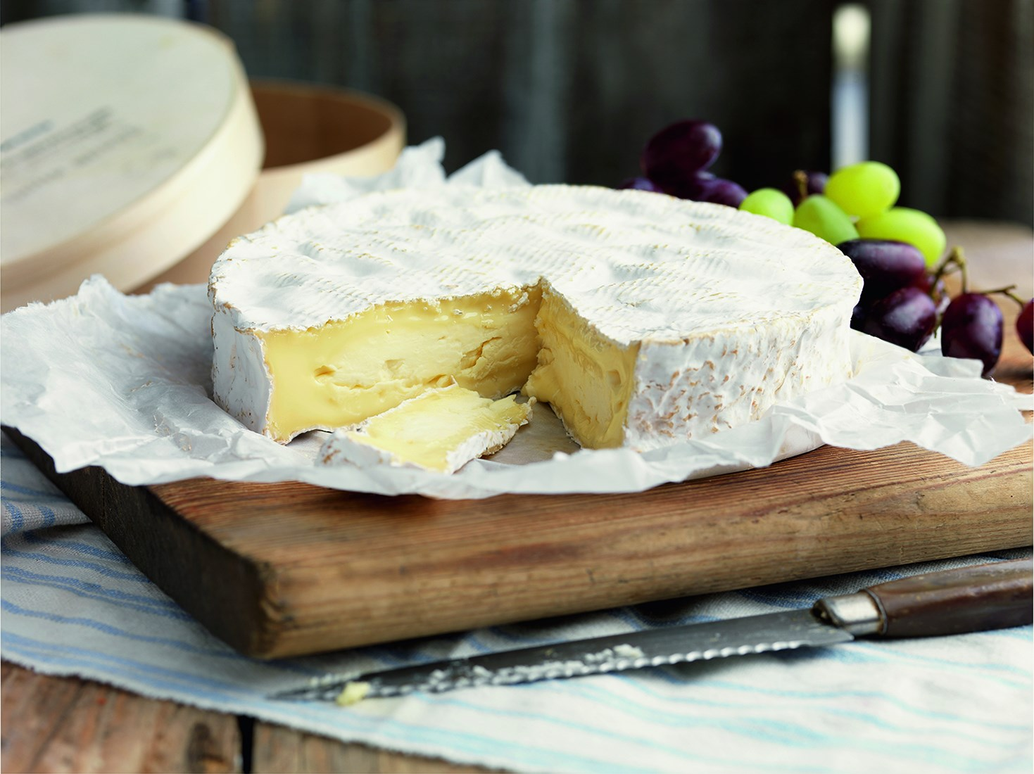 A large cheese on a board at The Deli at 40a in Newton-le-Willows