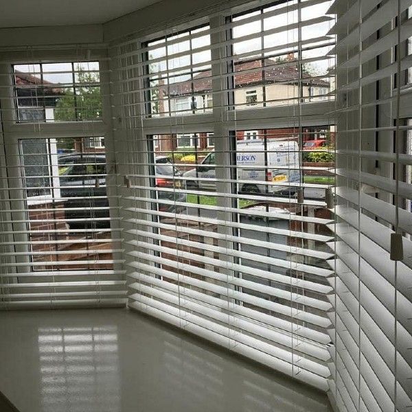 Wooden blinds by Grove Blind & Shutter Co.