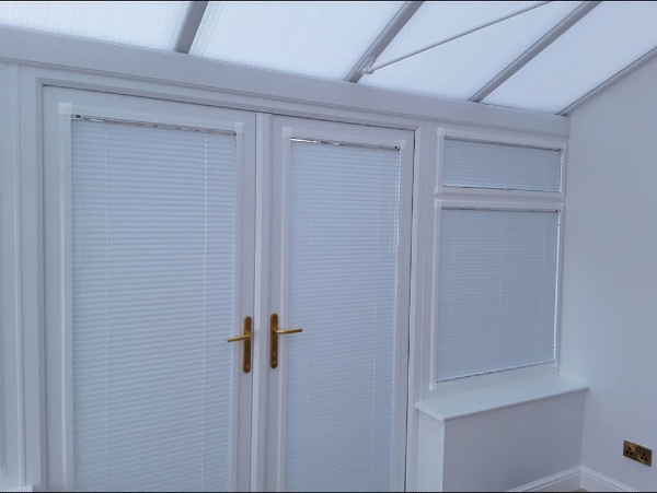 Pleated blinds by Grove Blind & Shutter Co.